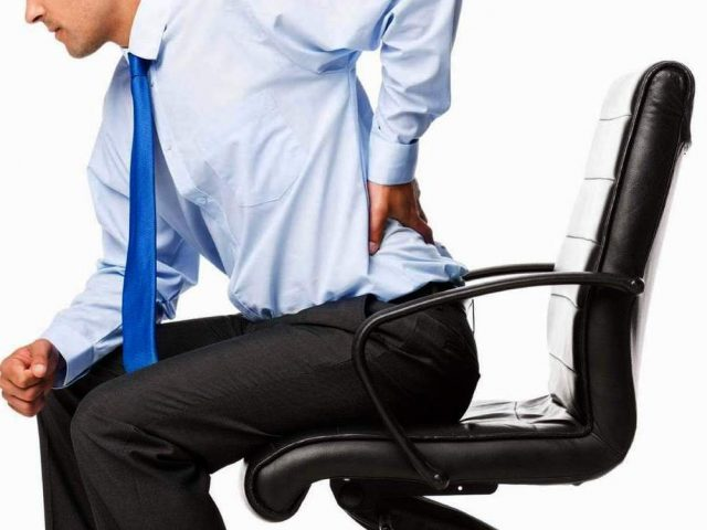 lower back and testicle pain when sitting